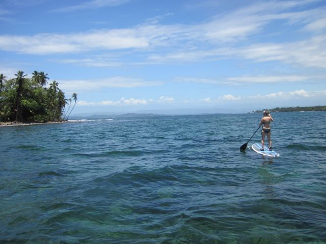 Our guest Jess on a SUP in front of The Firefly